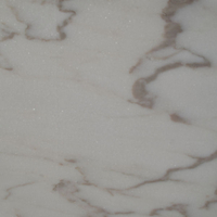 Estremoz veined, marble honed finish.
