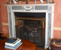 The Bossy fireplace ,  in white statuary marble, inlaid