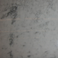 White Carrara marble, polished finish.
