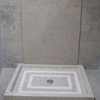 Solid shower tray in Fatima Blue limestone, honed finish.