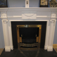 Carved Adam fireplace in white Sivec marble
