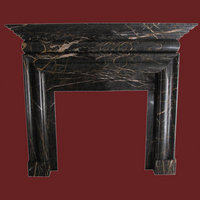The Bolection surround in noir st. laurent marble, polished